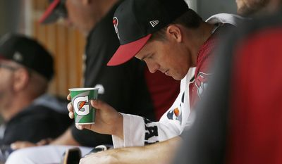 Arizona Diamondbacks' Zack Greinke sits in the dugout after pitching in the first inning of a spring training baseball game against the Chicago Cubs Thursday, March 23, 2017, in Scottsdale, Ariz. (AP Photo/Ross D. Franklin)