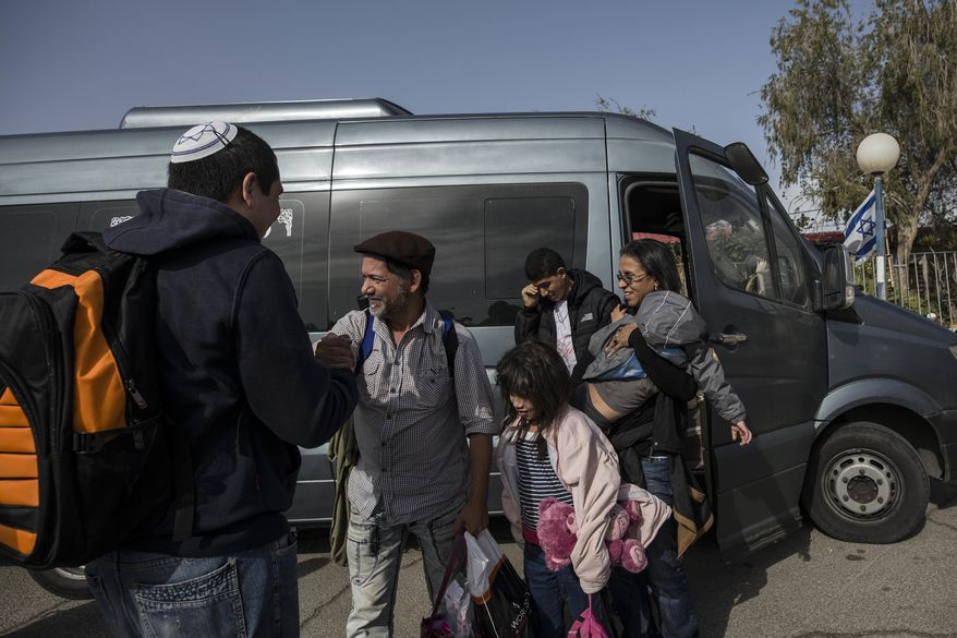 Perez family, Venezuelan Jewish converts, arrive to an absorption center in the southern city of Beersheba, Israel, Thursday, March 23, 2017. For a group of nine struggling Venezuelan converts to Judaism their torturous journey to a better life in the promised land finally brought them to Israel on Thursday. They immigrated under the Law of Return, which gives Jews the world over the right to settle in Israel, Israel, Thursday, March 23, 2017. (AP Photo/Tsafrir Abayov)