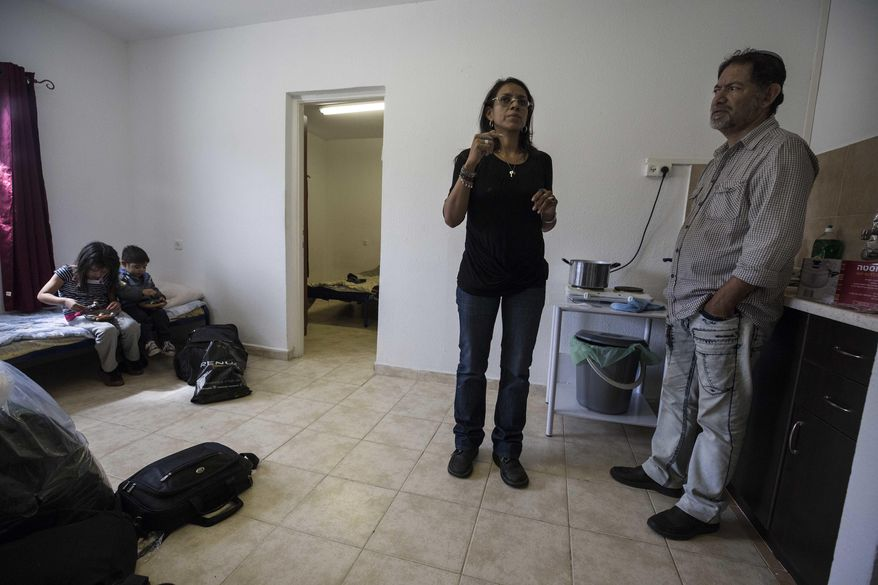 Venezuelan Jewish converts Franklin Perez and his wife Sahir Quitero, son Ezra and daughter Hannah settle in their new home in an absorption center in the southern city of Beersheba, Israel, Thursday, March 23, 2017. For a group of nine struggling Venezuelan converts to Judaism their torturous journey to a better life in the promised land finally brought them to Israel on Thursday. They immigrated under the Law of Return, which gives Jews the world over the right to settle in Israel, Israel, Thursday, March 23, 2017. (AP Photo/Tsafrir Abayov)