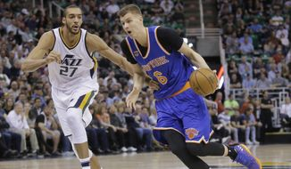 New York Knicks forward Kristaps Porzingis (6) drives around Utah Jazz center Rudy Gobert (27) during the first half during an NBA basketball game Wednesday, March 22, 2017, in Salt Lake City. (AP Photo/Rick Bowmer)