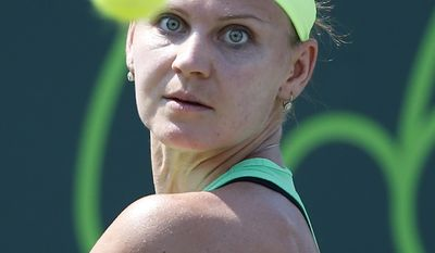 Lucie Safarova, of the Czech Republic, prepares to return a shot to Daria Gavrilova, of Australia, during a tennis match at the Miami Open, Thursday, March 23, 2017 in Key Biscayne, Fla. (AP Photo/Wilfredo Lee)