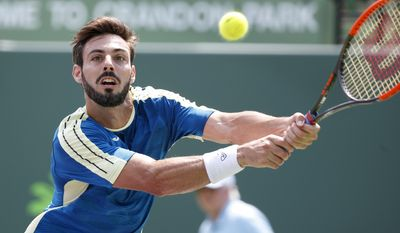 Marcel Granollers, of Spain, returns a shot from Borna Coric, of Croatia, during a tennis match at the Miami Open, Thursday, March 23, 2017 in Key Biscayne, Fla. (AP Photo/Wilfredo Lee)