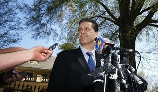 FILE - In this April 1, 2009, file photo, former Memphis basketball coach John Calipari answers question during a press conference with local media outside his East Memphis, Tenn., home, about leaving the university and heading to Kentucky to take over their storied program. The NCAA Tournament is bringing coach John Calipari back to the town where fans still hate him for ditching the Memphis Tigers for Kentucky in 2009, a decision all the more painful because the coach's best season was wiped off the books just months after leaving.  (Mark Weber/The Commercial Appeal via AP)