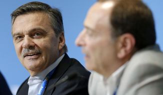 FILE - In this Feb. 18, 2014, file photo, International Ice Hockey Federation President Rene Fasel, left, listens as NHL Commissioner Gary Bettman, right, answers a question during a news conference addressing hockey issues at the 2014 Winter Olympics in Sochi, Russia. Fasel says he and national hockey federations need to know by the end of April whether the NHL will participate in Winter Olympics next year, or not. (AP Photo/Mark Humphrey, File)
