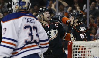 Anaheim Ducks center Rickard Rakell, right, of Sweden, celebrates his goal with center Ryan Getzlaf, center, against Edmonton Oilers goalie Cam Talbot, left, during the second period of an NHL hockey game in Anaheim, Calif., Wednesday, March 22, 2017. (AP Photo/Alex Gallardo)