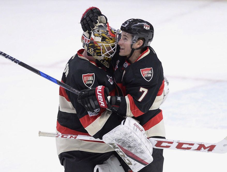 Ottawa Senators' Kyle Turris (7) celebrates with goalie Mike Condon (1) after his save against Pittsburgh Penguins' Sidney Crosby (87), not shown, during shootout of an NHL hockey game in Ottawa, Ontario, Thursday, March 23, 2017. Ottawa won, 2-1. (Justin Tang/The Canadian Press via AP)
