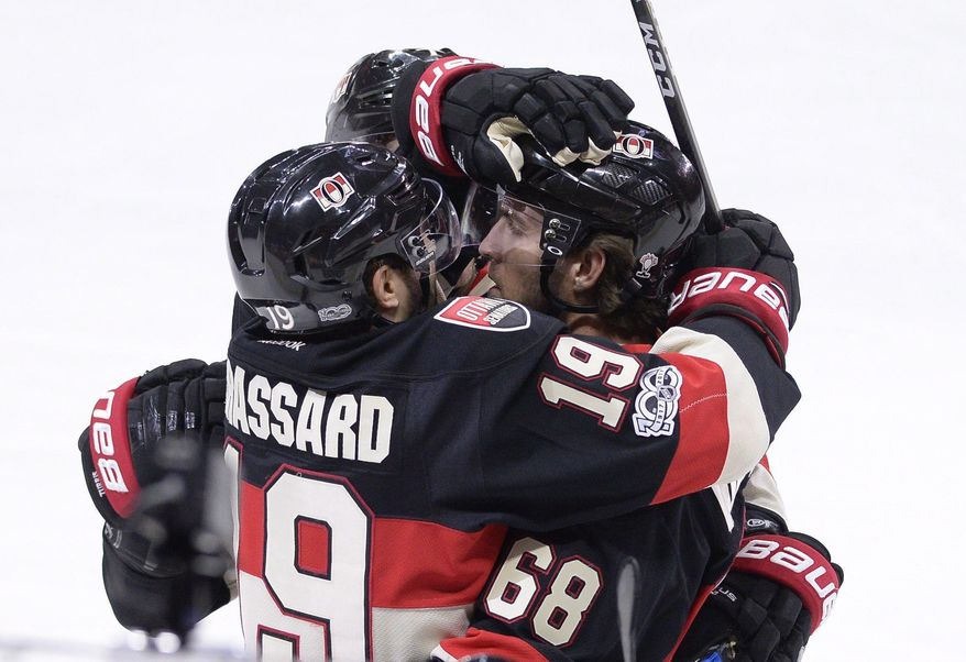 Ottawa Senators' Derick Brassard (19) celebrates his teammate Mike Hoffman's (68) tying goal against the Pittsburgh Penguins during the third period of an NHL hockey game in Ottawa, Ontario, Thursday, March 23, 2017. Ottawa won, 2-1, in the shootout. (Justin Tang/The Canadian Press via AP)