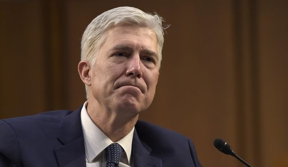 Supreme Court Justice nominee Neil Gorsuch listens as he is asked a question by Sen. Mazie Hirono, D-Hawaii, on Capitol Hill in Washington, Wednesday, March 22, 2017, during his confirmation hearing before the Senate Judiciary Committee. (AP Photo/Susan Walsh) ** FILE **