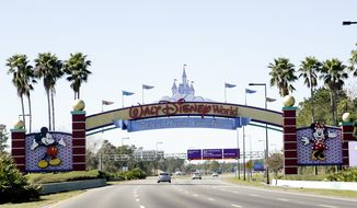 In this Tuesday, Jan. 31, 2017 photo, cars travel one of the roads leading to Walt Disney World in Lake Buena Vista, Fla. Orlando's top tourist destinations, Walt Disney World, Universal Orlando, SeaWorld and several resorts are in legal battles about how much they're worth with the local property appraiser and tax collector. (AP Photo/John Raoux)