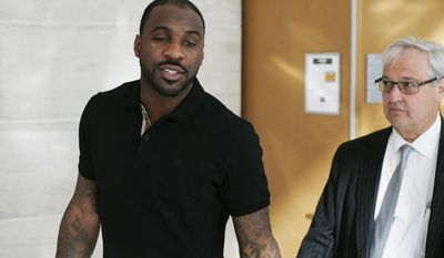 FILE - In this Tuesday, March 22, 2016, Sacramento Kings guard Ty Lawson and his attorney Harvey Steinberg, right, leave a hearing in Denver District Court in Denver. Lawson has denied that he violated his probation in a Colorado drunken driving case by drinking and failing to complete community service. Lawson and his attorney Harvey Steinberg made the assertion Thursday, March 23, 2017, during a brief appearance in a Denver courtroom. (AP Photo/David Zalubowski, File)