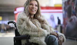 In this photo taken on Tuesday, March 14, 2017, Russian singer Yulia Samoylova who was chosen to represent Russia in the May 11-13 Eurovision Song Contest being held in the Ukrainian capital Kiev, poses while sitting in a wheelchair at Sheremetyevo airport outside Moscow, Russia. Ukraine's security service has banned Russia's 27-year old contestant Samoylova who has been wheelchair-bound since childhood, from this year's Eurovision song contest.(AP Photo/Maria Antipina)