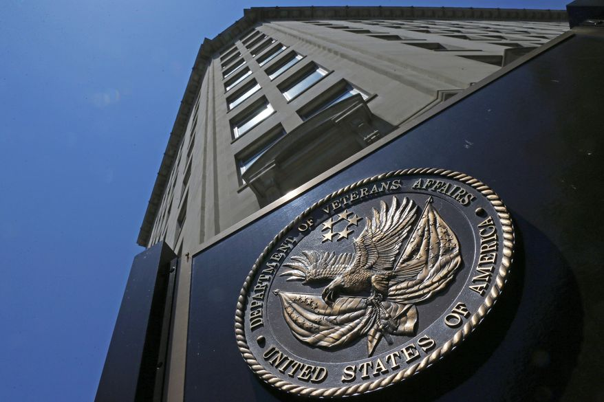 This June 21, 2013, file photo shows the seal affixed to the front of the Department of Veterans Affairs building in Washington. (AP Photo/Charles Dharapak, File)