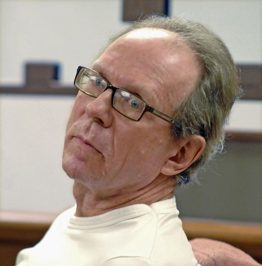 In this April 29, 2014 file photo, white supremacist Craig Cobb listens during court proceedings in Bismarck, N.D. Cobb, who unsuccessfully tried to turn the small North Dakota town of Leith into an all-white enclave says he thinks the burning of a building he recently bought in the town of Nome, N.D., was arson. (Tom Stromme/The Bismarck Tribune via AP, File)