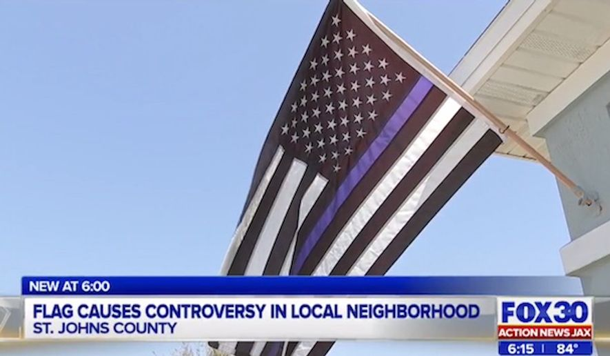 "A Florida family was ordered to take down a pro-cop flag in St. Johns County, which has flown outside their property for years. Their homeowners association denied a request for permission after someone complained it was ""racist."" (Fox 30 Action News JAX screenshot)"