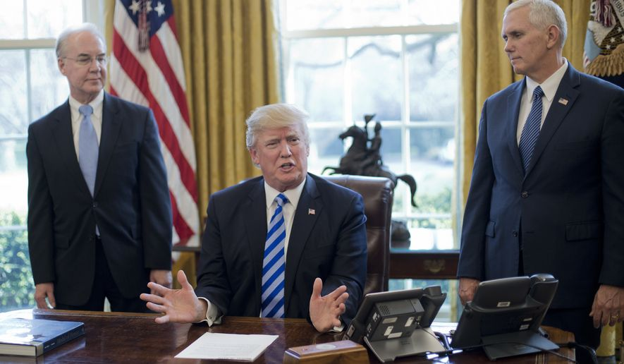 President Donald Trump, flanked by Health and Human Services Secretary Tom Price, left, and Vice President Mike Pence, right, speaks about the health care overhaul bill, Friday, March 24, 2017, in the Oval Office of the White House in Washington. (AP Photo/Pablo Martinez Monsivais)