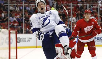 Tampa Bay Lightning left wing Ondrej Palat (18) celebrates his goal against the Detroit Red Wings in the third period of an NHL hockey game Friday, March 24, 2017, in Detroit. (AP Photo/Paul Sancya)
