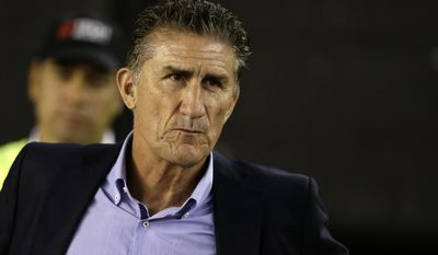 Argentina's coach Edgardo Bauza  stands before a 2018 Russia World Cup qualifying soccer match between Argentina and Chile at the Monumental stadium in Buenos Aires, Argentina, Thursday March 23, 2017.(AP Photo/Victor R. Caivano)