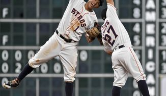 FILE - In this Aug. 30, 2016, file photo, Houston Astros' Carlos Correa (1) and Jose Altuve celebrate the Astros' 3-1 victory over the Oakland Athletics in a baseball game, in Houston. Now that the Cubs have broken baseball's oldest curse, who's next? No team from Texas has ever won the World Series.  (AP Photo/Eric Christian Smith, File)