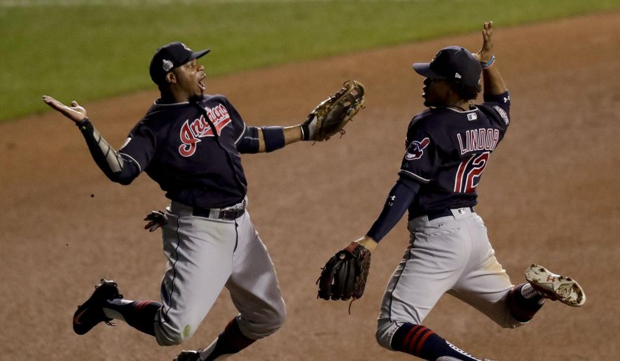FILE - In this Oct. 29, 2016, file photo, Cleveland Indians left fielder Rajai Davis, left, and shortstop Francisco Lindor celebrate their win after Game 4 of the Major League Baseball World Series against the Chicago Cubs, in Chicago. Now that the Cubs have broken baseball's oldest curse, who's next? Maybe it's the Indians' turn.  (AP Photo/Charles Rex Arbogast, File) **FILE**