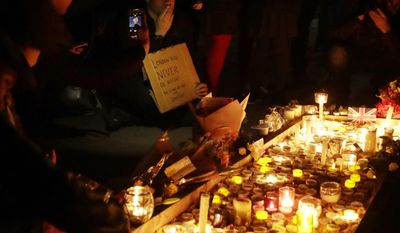 People light candles at a vigil for the victims of Wednesday's attack, at Trafalgar Square in London, Thursday, March 23, 2017. The Islamic State group has claimed responsibility for an attack by a man who plowed an SUV into pedestrians and then stabbed a police officer to death on the grounds of Britain's Parliament. Mayor Sadiq Khan called for Londoners to attend a candlelit vigil at Trafalgar Square on Thursday evening in solidarity with the victims and their families and to show that London remains united. (AP Photo/Matt Dunham)
