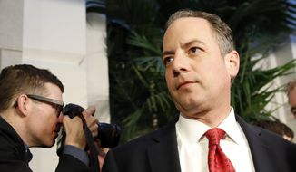 White House Chief of Staff Reince Priebus, right, departs after a Republican caucus meeting on Capitol Hill, Thursday, March 23, 2017, in Washington. (AP Photo/Alex Brandon) ** FILE **