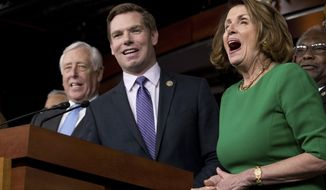 House Minority Leader Nancy Pelosi of Calif., right, and Democratic Whip Steny Hoyer, D-Md., react at a joke from Rep. Eric Swalwell, D-Calif., center, as he jokes while speaking at a news conference on Capitol Hill in Washington, Friday, March 24, 2017. Republican leaders have abruptly pulled their troubled health care overhaul bill off the House floor, short of votes and eager to avoid a humiliating defeat for President Donald Trump and GOP leaders.(AP Photo/Andrew Harnik)