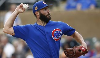 Chicago Cubs' Jake Arrieta throws a pitch against the Arizona Diamondbacks during the first inning of a spring training baseball game Thursday, March 23, 2017, in Scottsdale, Ariz. (AP Photo/Ross D. Franklin)