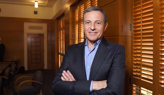 Bog Iger, chairman and CEO of The Walt Disney Company, poses in a conference room in Burbank, California, Dec. 10, 2015. (AP Photo/Mark J. Terrill) ** FILE **