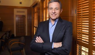In this Thursday, Dec. 10, 2015, file photo, Bob Iger, chairman and CEO of The Walt Disney Company, poses in a conference room before speaking to members of the media about bringing NFL football back to the Los Angeles area, in Burbank, Calif. (AP Photo/Mark J. Terrill, File)