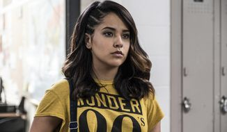 """In this image released by Lionsgate, Becky G portrays Trini, the Yellow Ranger, in a scene from """"Power Rangers."""" (Kimberly French/Lionsgate via AP)"""