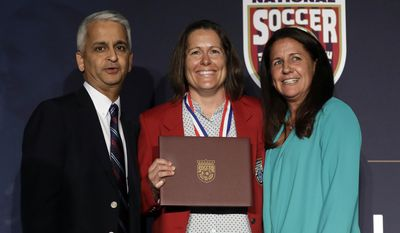 Shannon MacMillan, center, poses for a photo with U.S. Soccer Federation President Sunil Gulati, left, and teammate Joy Fawcett, right, during an induction ceremony for the National Soccer Hall of Fame pm Friday, March 24, 2017, in San Jose, Calif. (AP Photo/Marcio Jose Sanchez)