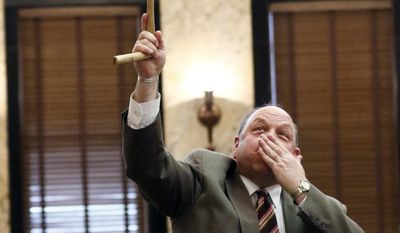 Rep. Steve Holland, a Plantersville Democrat, known for his flag waving antics, dramatic speeches and humor, blows a kiss to a friend in the gallery in House Chambers at the Capitol in Jackson, Miss., Friday, March 24, 2017. Holland earlier told lawmakers that he has dementia and will retire after this legislative term. (AP Photo/Rogelio V. Solis)