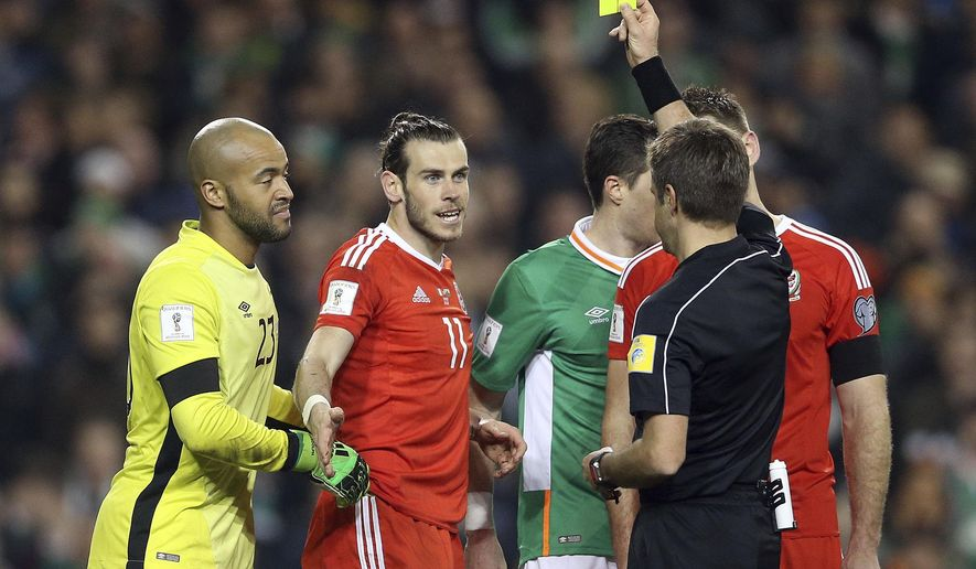 Wales' Gareth Bale gets a yellow card during their 2018 World Cup Group D qualifying soccer match against Ireland at the Aviva Stadium, Dublin, Ireland, Friday, March 24, 2017. (Brian Lawless/PA via AP)