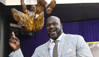 Shaquille O'Neal poses after the unveiling of his statue in front of Staples Center, Friday, March 24, 2017, in Los Angeles. (AP Photo/Mark J. Terrill)