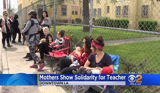 A group of mothers nursed their babies outside Metropolitan High School in downtown Los Angeles Wednesday to protest the districts allegedly oppressive breastfeeding policies. (CBSLA)