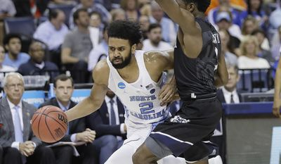 North Carolina guard Joel Berry II (2) drives against Butler guard Kamar Baldwin in the second half of an NCAA college basketball tournament South Regional semifinal game Friday, March 24, 2017, in Memphis, Tenn. (AP Photo/Mark Humphrey)