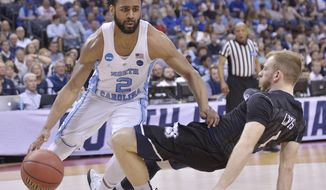 North Carolina guard Joel Berry II (2) moves past Butler guard Tyler Lewis in the first half of an NCAA college basketball tournament South Regional semifinal game Friday, March 24, 2017, in Memphis, Tenn. (AP Photo/Brandon Dill)