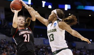 Louisville forward Kylee Shook (21) attempts a shot over Baylor forward Nina Davis (13) during the first half of a regional semifinal of the NCAA women's college basketball tournament, Friday, March 24, 2017, in Oklahoma City. (AP Photo/Sue Ogrocki)