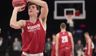 Wisconsin forward Ethan Happ (22) practices his free throws during practice, Thursday, March 23, 2017, at Madison Square Garden in New York. Wisconsin will play Florida on Friday in an east regional semifinal of the NCAA college basketball tournament. (AP Photo/Julie Jacobson)