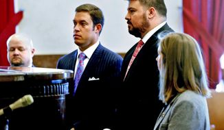 Former Oklahoma State Sen. Ralph Shortey, second from left, makes his first court appearance with his lawyer Ed Blau at the Cleveland County Courthouse on Friday, March 24, 2017, in Norman, Okla. Shortey is charged with child prostitution involving a 17-year-old boy. (Steve Sisney/The Oklahoman via AP)