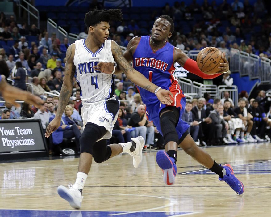 Orlando Magic's Elfrid Payton (4) tries to slow down Detroit Pistons' Reggie Jackson (1) who moves to the basket during the first half of an NBA basketball game, Friday, March 24, 2017, in Orlando, Fla. (AP Photo/John Raoux)
