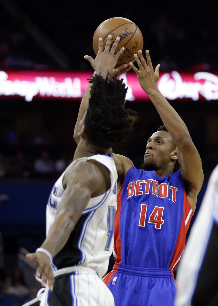 Detroit Pistons' Ish Smith (14) shoots over Orlando Magic's Elfrid Payton during the first half of an NBA basketball game, Friday, March 24, 2017, in Orlando, Fla. (AP Photo/John Raoux)