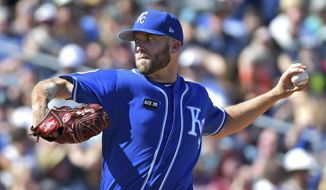 Kansas City Royals starting pitcher Danny Duffy throws against the Seattle Mariners during a spring training baseball game Friday, March 24, 2017, in Peoria, Ariz. (John Sleezer/The Kansas City Star via AP)