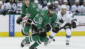 Dallas Stars defenseman Greg Pateryn (29) chases the puck in front of teammate Jamie Oleksiak (5) and San Jose Sharks center Micheal Haley (38) during the second period of an NHL hockey game in Dallas, Friday, March 24, 2017. (AP Photo/LM Otero)