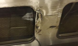 In this image provided by Jordan Geary shows the side of a New Jersey Transit train that is damaged, Friday, March 24, 2017 in New York's Penn Station. The train clipped an Amtrak Acela Express during the morning rush at Penn Station, jolting commuters and creating major travel disruptions but causing no serious injuries. (Jordan Geary via AP)