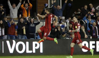 United States' Clint Dempsey, center, celebrates his free-kick goal with teammate Geoff Cameron, right, during the second half of a World Cup qualifying soccer match against Honduras on Friday, March 24, 2017, in San Jose, Calif. (AP Photo/Marcio Jose Sanchez)