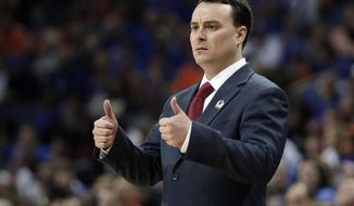 FILE - In this March 29, 2014, file photo, Dayton head coach Archie Miller gestures during the first half in a regional final game at the NCAA college basketball tournament against Florida in Memphis, Tenn. Indiana has hired Miller as its new coach on Saturday, March 25, 2017. (AP Photo/Mark Humphrey, File)