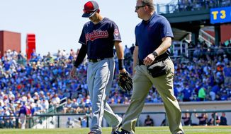 Cleveland Indians' Lonnie Chisenhall, left, leaves a baseball game with assistant trainer Jeff Desjardins, right, during the third inning of a spring training baseball game against the Chicago Cubs,Friday, March 24, 2017, in Mesa, Ariz. (AP Photo/Ross D. Franklin)