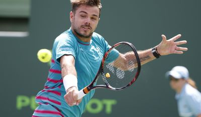 Stan Wawrinka, of Switzerland, returns a shot from Horacio Zeballos, of Argentina, during a tennis match at the Miami Open, Saturday, March 25, 2017 in Key Biscayne, Fla. (AP Photo/Wilfredo Lee)