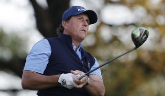 Phil Mickelson watches his tee shot on the first hole during the round of 16 play at the Dell Technologies Match Play golf tournament at Austin County Club, Saturday, March 25, 2017, in Austin, Texas. (AP Photo/Eric Gay)